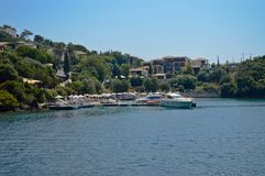 Bay of rich greek people and tourists. One of the richest islands and its bay in Greece Royalty Free Stock Image