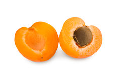 One ripe fresh apricot halves isolated on white background. One apricot cut in halves with seed inside, isolated on white background. Closeup image of sweet royalty free stock image