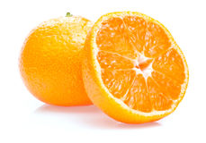 One ripe juicy tangerine and half  Royalty Free Stock Photos
