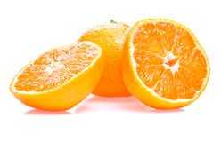 One ripe juicy tangerine and two half  Royalty Free Stock Image