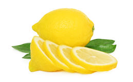 One ripe lemon and slices with green leaves () Royalty Free Stock Image