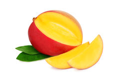 One ripe mango with slices on white background Stock Photography