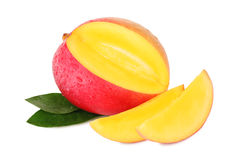 One ripe mango and two slices with drops () Stock Photos