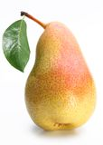 One ripe pear with a leaf. Stock Photo