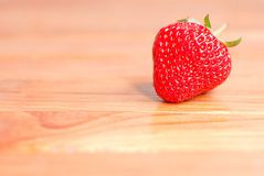 One of ripe strawberries on table, side view Stock Photo