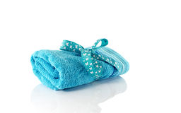 One rolled blue towel Stock Photo