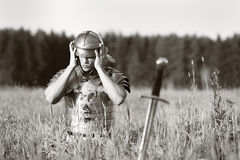One Roman soldier in field. Royalty Free Stock Image