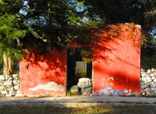 Small ruined house with red facade in abandoned hacienda in Yucatan, Mexico Royalty Free Stock Images