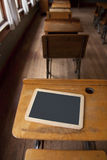 One room school house with desks and chalk board Royalty Free Stock Images