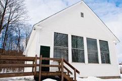 One room schoolhouse in snow Stock Photo