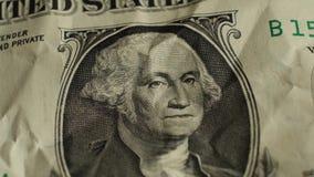 One rotating battered dollar bill. Macro. stock video