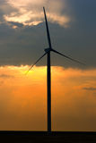 One rotating wind turbine at sunset Royalty Free Stock Photos