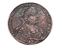 One rouble coin of 1727 years. Russian one rouble coin of 1727 years. The Ekaterina First portrait on one side, and two headed eagles with crown on the other Royalty Free Stock Photography