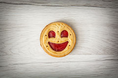 One round biscuit smiling face, humorous sweet food Royalty Free Stock Photos