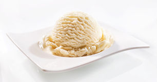 One rounded scoop of vanilla ice cream in bowl Royalty Free Stock Photography