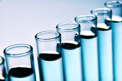 One row of full test tubes background. One row of full glass test tubes background. Elevated view Royalty Free Stock Photos