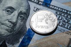 One ruble coin on dollar banknote Royalty Free Stock Photography