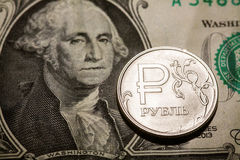 One ruble coin on dollar banknote Stock Photo