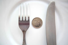 One ruble coin on a white plate Royalty Free Stock Photo