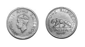 One Rupee Coin British. A historic last minted One Rupee Coin of British Rule in the name of George VI King Emperor of Bombay(Mumbai) Mint dated 1947.  In this Stock Image
