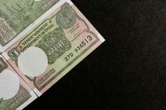 One rupee notes on black background royalty free stock image