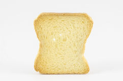 One rusk. On white background Royalty Free Stock Photos