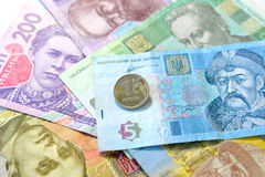 One Russian ruble against the Ukrainian paper money Royalty Free Stock Image