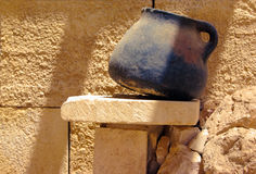 One rusty pot. Old rusty clay pot on the sandstone bricks Stock Photos