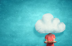With one's head in clouds. Unrecognizable businesswoman with cloud instead of head Stock Photo