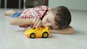 One sad little boy lying on the floor at home  at the day time. Sad little boy lying on the floor at home  at the day time. Concept of sorrow stock video footage