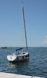 One sailboat moored in harbor in Trieste,Italy on summer day Stock Photo