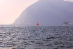 One sailing boat into Iseo lake during the sunset royalty free stock images