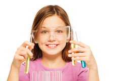 One schoolgirl in safe eyewear studying chemistry Royalty Free Stock Photo