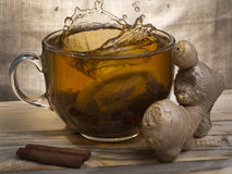 Lemon in a cup of tea. One segment of a lemon is thrown into a cup of tea Stock Photo