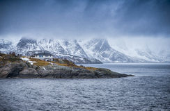 One Separate House on Seashore Coastline in Norway Against Mountains. Travel and Tourism Concepts. One Separate House on Seashore Coastline in Norway Against Stock Photography