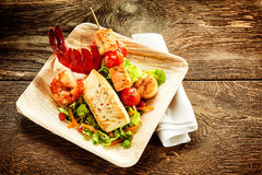 One serving of roasted seafood salad on plate Stock Images