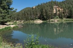 One of several ponds at Fawn Lakes in northern New Mexico. This is one of several fishing ponds which make up Fawn Lakes in the Carson National Forest in stock photos