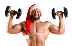 Double bicep Santa Claus with muscular body in red and white christmas hat, torso. White background, Isolated, alone Royalty Free Stock Images
