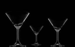 One Sharp and Two Blur Cocktail glasses on black Stock Photos