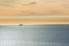 One ship sailing in the pacific ocean during sunset close to San Diego, California Stock Photography