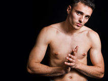 One shirtless young man isolated on black Royalty Free Stock Photography