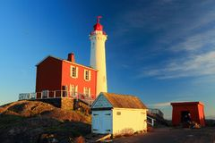 Winter Evening Sun shining on Fisgard Lighthouse, Fort Rodd Hill National Historic Site, Victoria. On one of the shortest days of the year, the winter sun Stock Photo