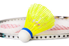 One shuttlecock lying near the badminton racket Stock Photography