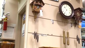 One side of antique wall clocks in a clock store stock video