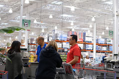 One side of check out counter inside Costco store. One side of cashier scanning food and stocking them on trolley at check out counter inside Costco Royalty Free Stock Photo