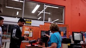 One side of check out counter inside Home depot store stock video footage