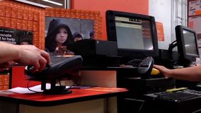 One side of check out counter inside Home depot store stock footage