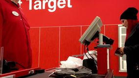 One side of check out counter inside Target store stock video