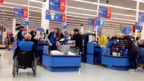 One side of check out counter inside Walmart store stock footage