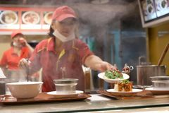 One side of chef cooking food for customer with heavy steam Stock Photography